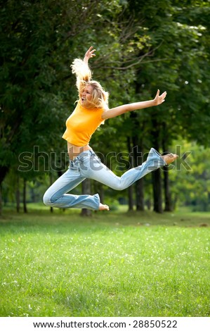 Wow jump of funny lovely woman outdoors
