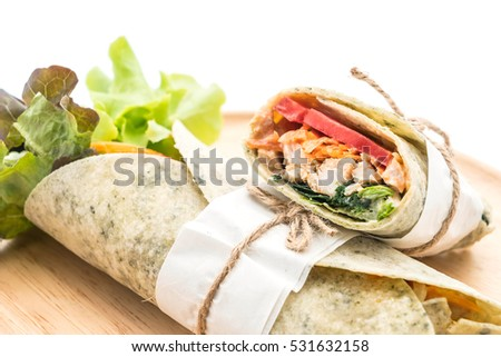 wrap salad roll with chicken and spinach on white background