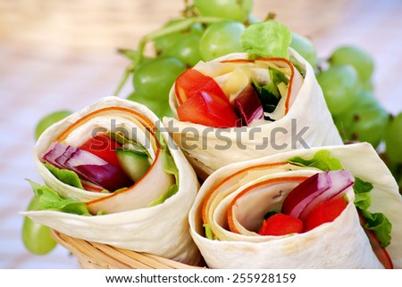 Wrap sandwich : Ham and cheese wrap sandwiches in picnic basket