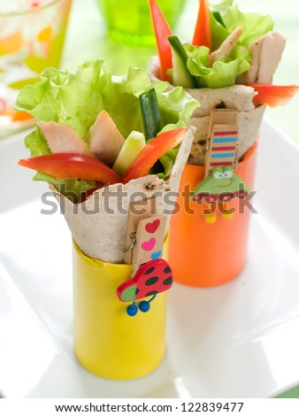 Wrap with grilled chicken and vegetables for children party, selective focus