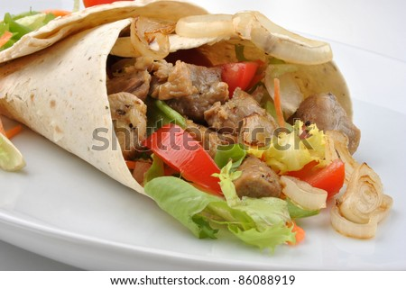 wrap with grilled pork and some vegetable