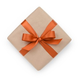 wrapped brown present box with orange ribbon bow, isolated on white