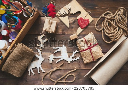 Wrapped Christmas gifts and symbols over wooden background #228705985