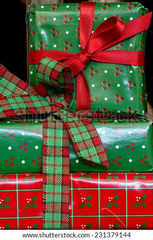 Wrapped Christmas packages in green and red