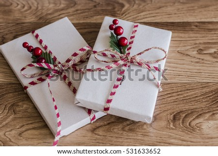 Wrapped Christmas presents on a wood background #531633652