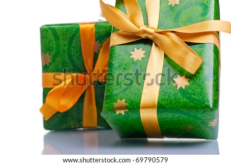 Wrapped gift boxes with ribbons and bows isolated