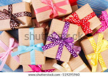 Wrapped gifts with colorful ribbons for Christmas, Valentine, birthday or other celebration lying on old boards #519295960