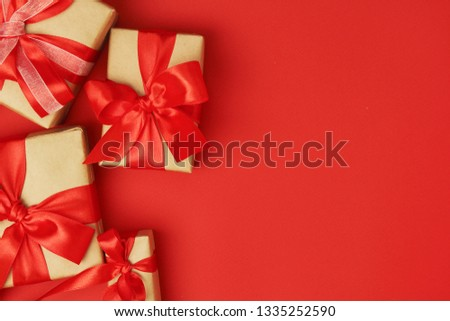Wrapped presents with bright red background with copy space #1335252590