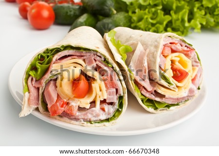 wrapped tortilla sandwich rolls cut in half and ingredients
