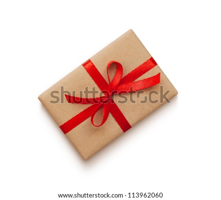 Wrapped vintage gift box with red ribbon bow, isolated on white