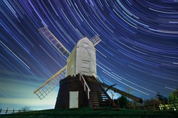 Wrawby Postmail under the clear night sky, dramatic long exposure astrophotography showing beautiful stars & star trails
