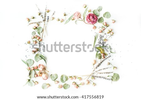wreath frame with roses, lavender, branches, leaves and petals isolated on white background. flat lay, overhead view #417556819