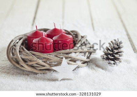 Wreath, red candles, wooden star, fir cone, copy space