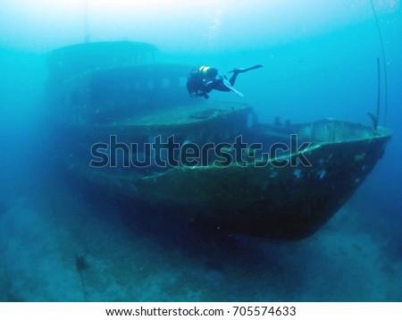 wreck diving underwater ship #705574633