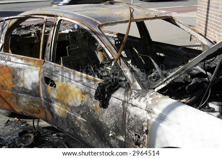 wrecked abandoned burnt out car with melted interior fire damage stock photo 2964514