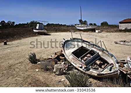 Wrecks of old fishing boats in Greece