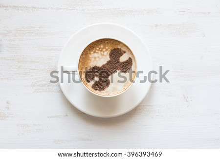 Wrench made of cinnamon powder in cappuccino. Enterprise asset management, EAM software. Repair service concept. Technical support concept