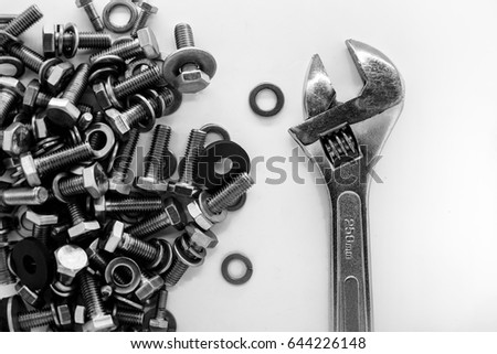 Wrench ,Nuts Bolts on white ground top view #644226148
