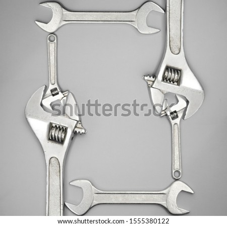 wrenches frame isolated on gray background. Wrench tools equipment with empty copy space. #1555380122