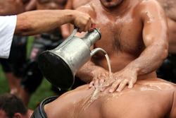 Wrestlers are meticulously preparing for oil wrestling traditionally held in Muğla's Kavaklıdere district.