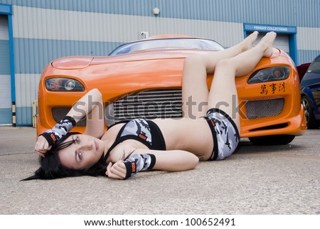 WREXHAM, ENGLAND - JUNE 13 : Club Promo Girl with Mazda RX7 on June 13th 2009 in Wrexham, England, UK. Demon Tweeks is the host of Shropshire Modified and Performance Car Club Charity Event
