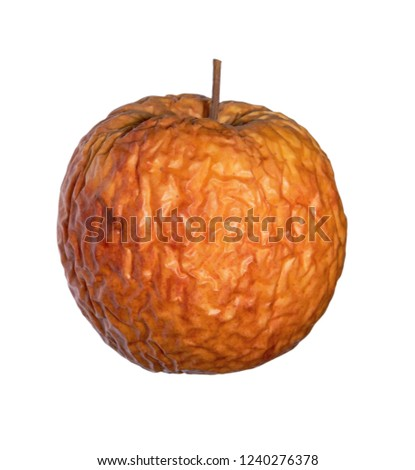 Wrinkled apple isolated on white background with clipping path.