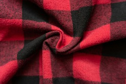 Wrinkled black and red cell clothes background. Fabric with black red cages pattern. Plaid material. Crumpled Cloth Blank Background