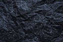 wrinkled black paper texture or background made from paper