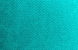 Wrinkled bright turquoise silver fabric. Texture background for design.