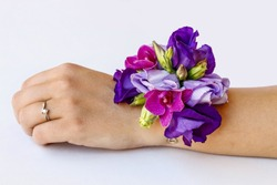 Wrist corsage made of violet and purple eustoma flowers