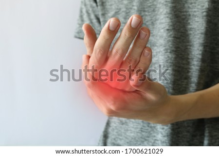 Wrist pain. Wrist and hand pain. Holding wrist pain from injury. Man holding his wrist symptomatic office syndrome or carpal tunnel syndrome. Pain at hand from arthritis and repetitive motion.