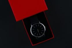 wristwatch in a red box on a dark background