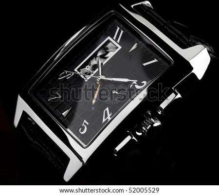 wristwatch on a black