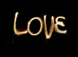 Write sentences with an animated Sparkler light alphabet  Love on black background