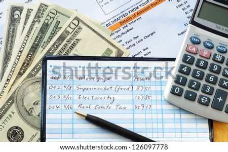 Write some checks to make payments for household expenses