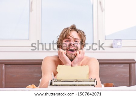 Writer handsome author used old fashioned manual typewriter. Morning bring fresh idea. Need inspiration. Crisis creativity. Daily routine of writer. Man writer lay bed with breakfast working.