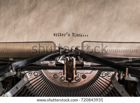 Writer's Block words typed on a Vintage Typewriter. Mechanisms closeup. Typing on old typewriter #720843931