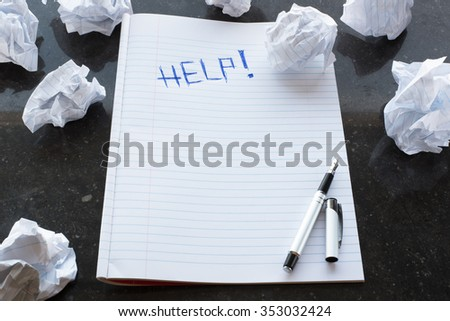 Writers Block. Help!. Writing. Paper lump. Marble background.
