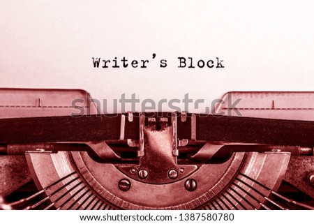 Writers Block printed on a sheet of paper on a vintage typewriter. writer, journalist.
