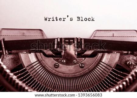 Writers Block printed on a sheet of paper on a vintage typewriter. writer. literature.
