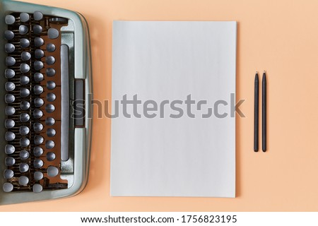 Writers work. Authorship concept. New chapter. Top view of vintage typewriter, clear sheet and pens on peach background Photo stock ©