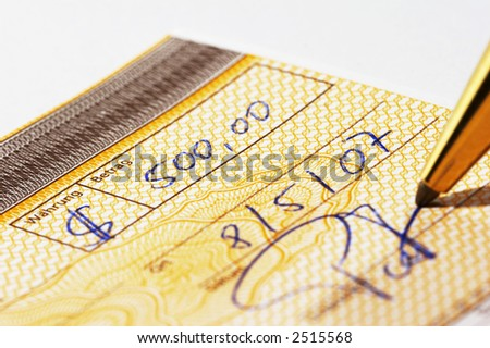 Writing a bank check with a pen