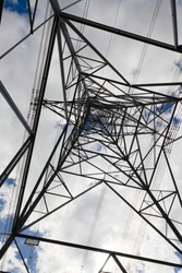 Writing and telephone number removed from this plain image of an electrical pylon. This post is industrial distribution infrastructure for the grid