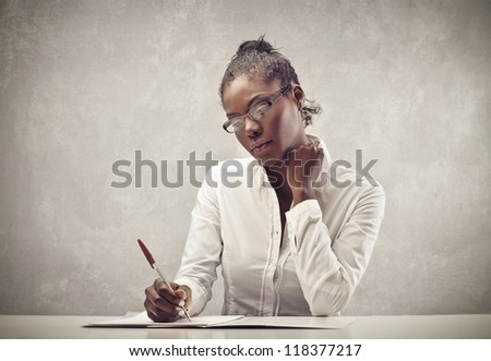 Writing black woman with a white shirt