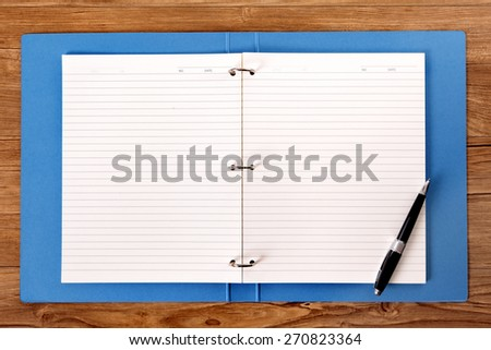 https://image.shutterstock.com/display_pic_with_logo/87057/270823364/stock-photo-writing-book-on-student-desk-ballpoint-pen-copy-space-270823364.jpg