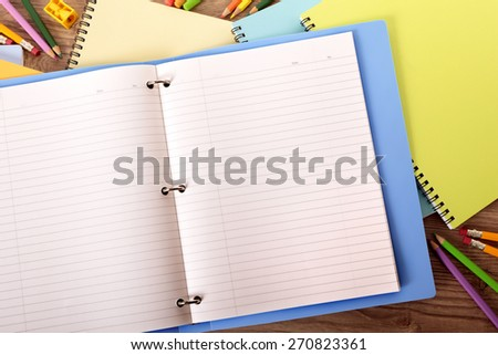 https://image.shutterstock.com/display_pic_with_logo/87057/270823361/stock-photo-writing-book-ring-binder-on-student-desk-copy-space-270823361.jpg