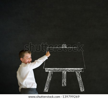 Writing boy dressed up as business man with learn art chalk easel on blackboard background