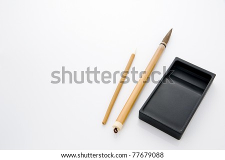 Writing brush and ink stone isolated on white background