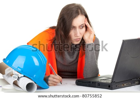 writing female architect or engineer with laptop and blueprint, series - stock photo