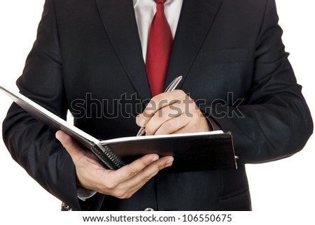 Writing hand on white page with a pen